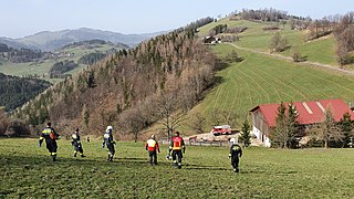 2020-03-27 (115) People after rescue of a person in an alpine terrain in Schroffengegend, Loich, Austria.jpg
